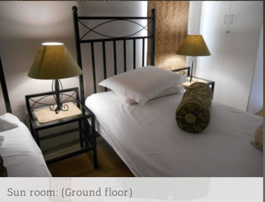 Sun Room: Elegantly furnished room with two single beds or one king size bed. Sleeps 2 people only. En suite bathroom with shower only. Strictly Non-Smoking. Dinner on request. Laundry service at minimum charge. Room service daily. Safe off-street parking.