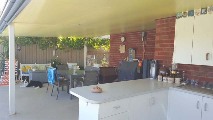 Outdoor dining area from outdoor kitchen/bar