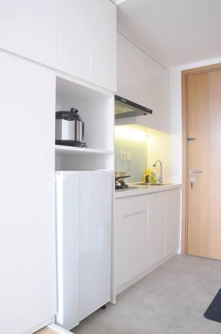 Kitchen set with refrigerator and kitchen utensils