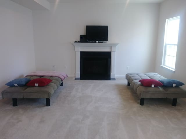 Two convertible sofas in living room
