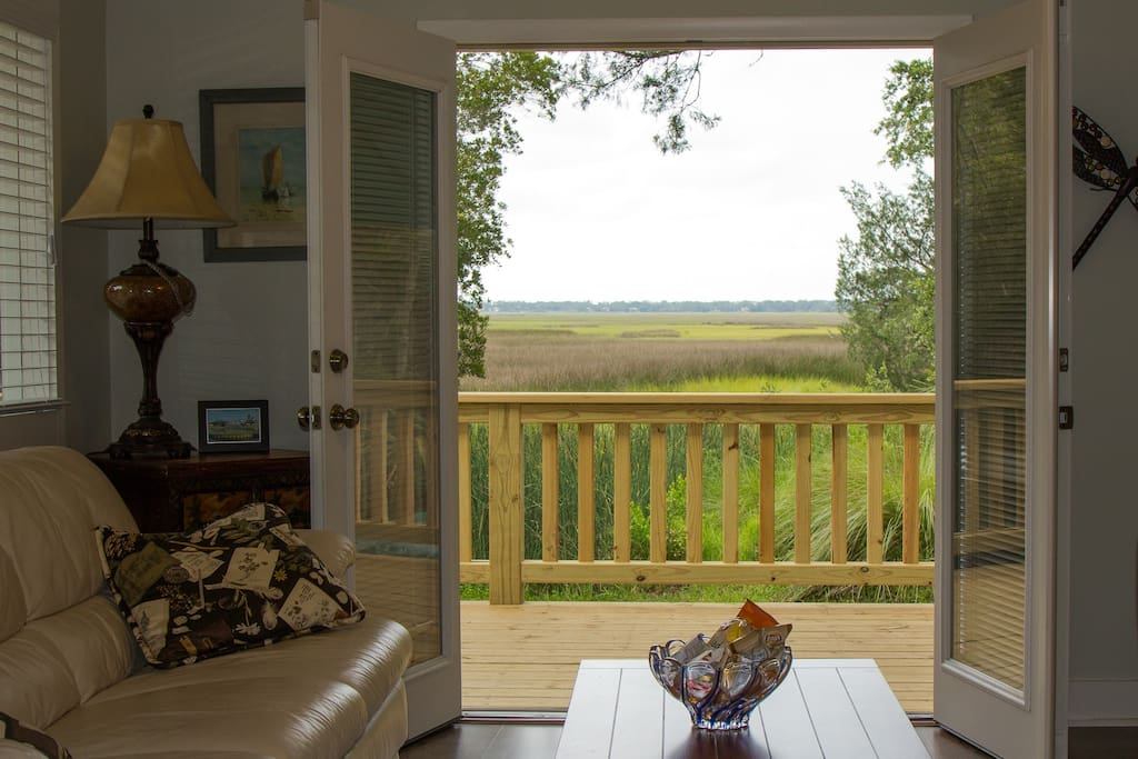 French doors open to a view of the marsh...