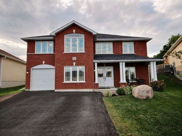 A professional staging model home with tones nature light and windows. Beautiful backyard  with patio set for you to enjoy with a nice morning coffee.
