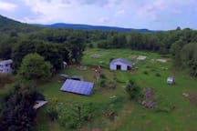 GHF From Drone... Tree house, solar panels, house, barn, and field