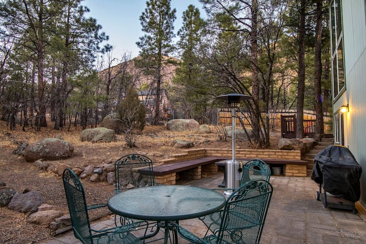 Relax after a long day in the tranquil forest, gazing at Mount Elden