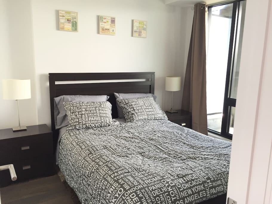 Closed bedroom with queen size bed