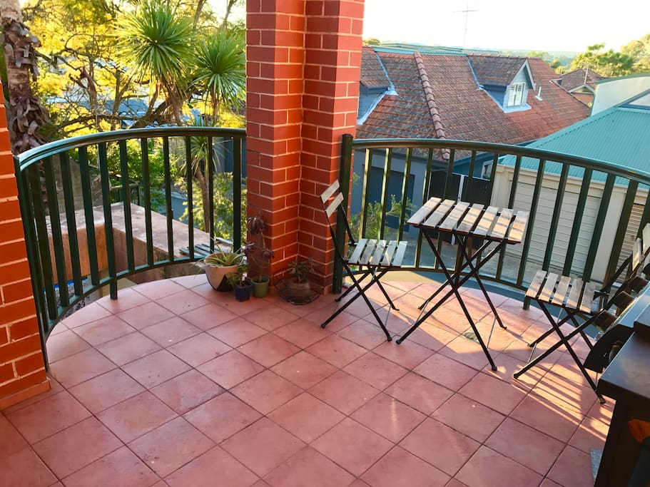 Sunny round balcony with table and chairs set - Overlooks quiet private road