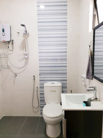 Attached bathroom with shower heater