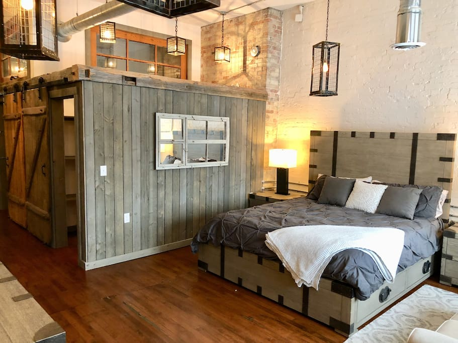 California king sized bed from RH, shiplap barn siding and custom antique mirror