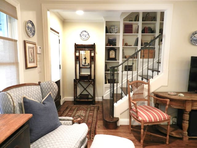 Private entrance that greets you to an open living and dining area