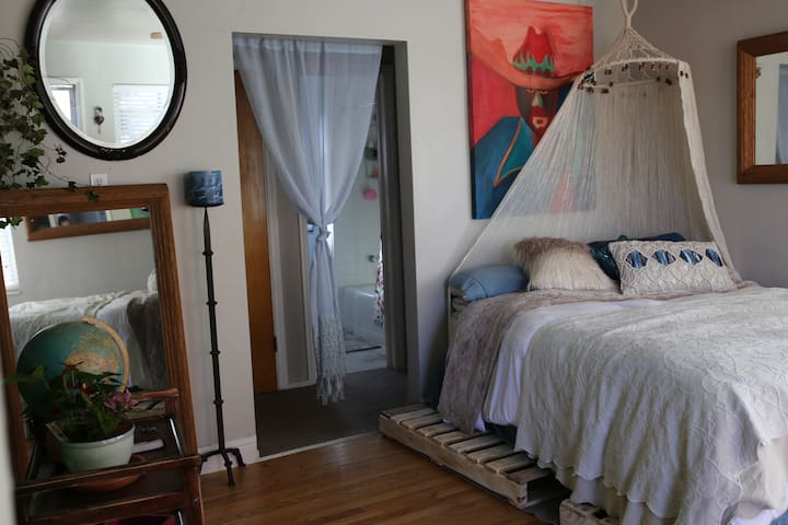 Cute Retro Townhome with Wood Floors and Art