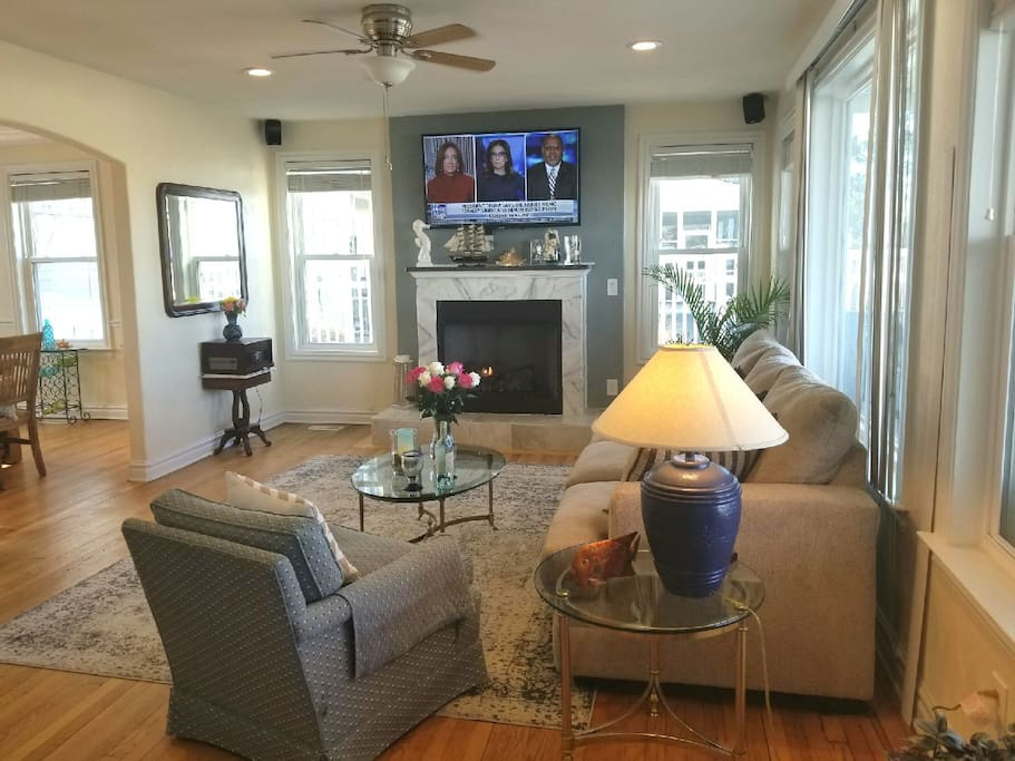 Living room with views of the Chesapeake Bay & Pool, gas fireplace, smart t.v.