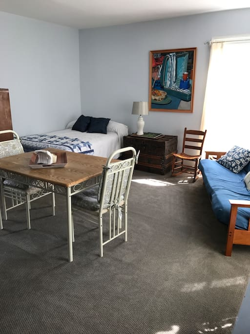 The shared living space includes a double bed, a futon (which converts easily to a bed), and a full kitchen and dining area.  There is extra bedding available.