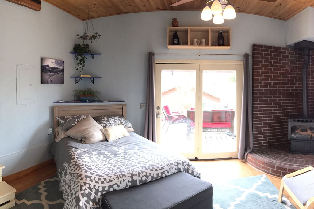 Modest, yet cozy and comfy bedroom with private deck access and gas stove.