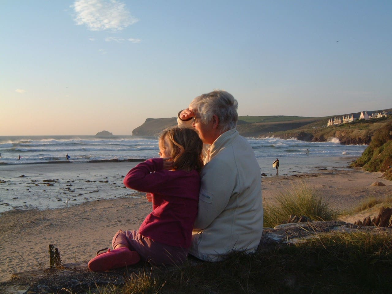 Sitting on the garden wall, this close to the sea!  One of our guests, Anne with her lovely granddaughter.