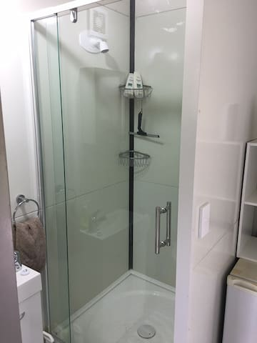 Full size shower, powered by gas califont so it has GREAT pressure.