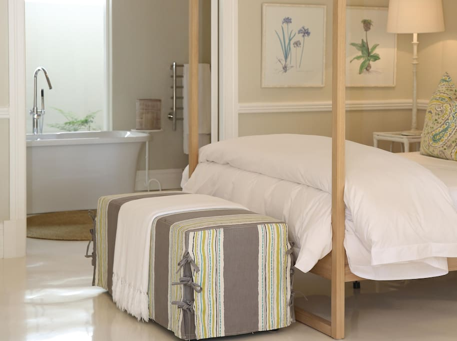 Our beds are made up in cotton linen and feather and down pillows and duvet