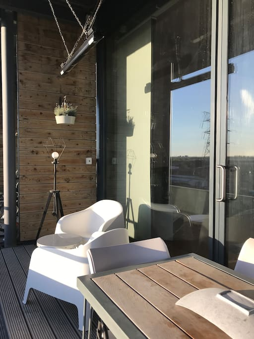Sunny balcony with overhead heating