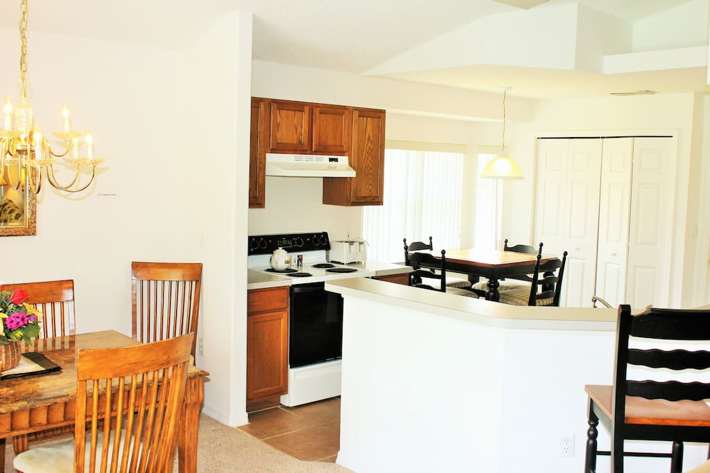 Well-fitted kitchen with breakfast nook and Dining table