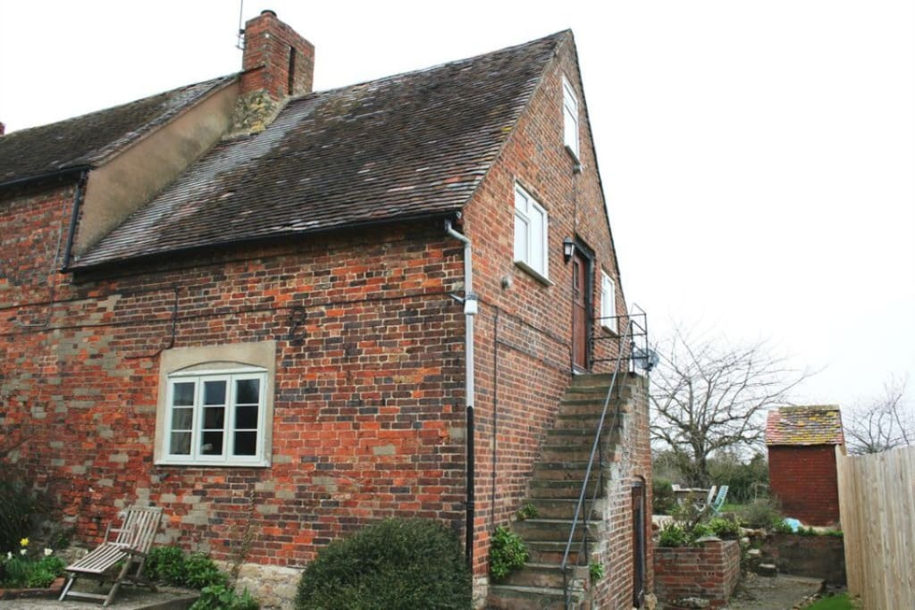 Self contained granary annexe . Entrance via stone staircase at side of farm