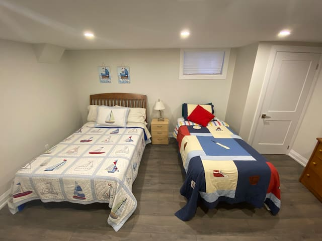 Basement bedroom with double bed and twin bed