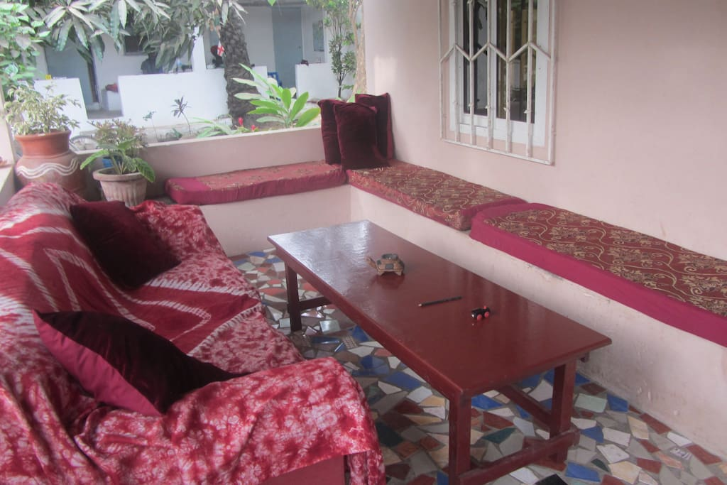 The comfortable veranda of the main house available to guests and visitors. A kitchen area with gas and other facilities at one end.