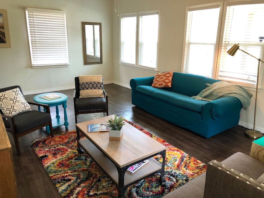 Lots of natural light in the living room. Enjoy all the new surfaces, furniture and fixtures!