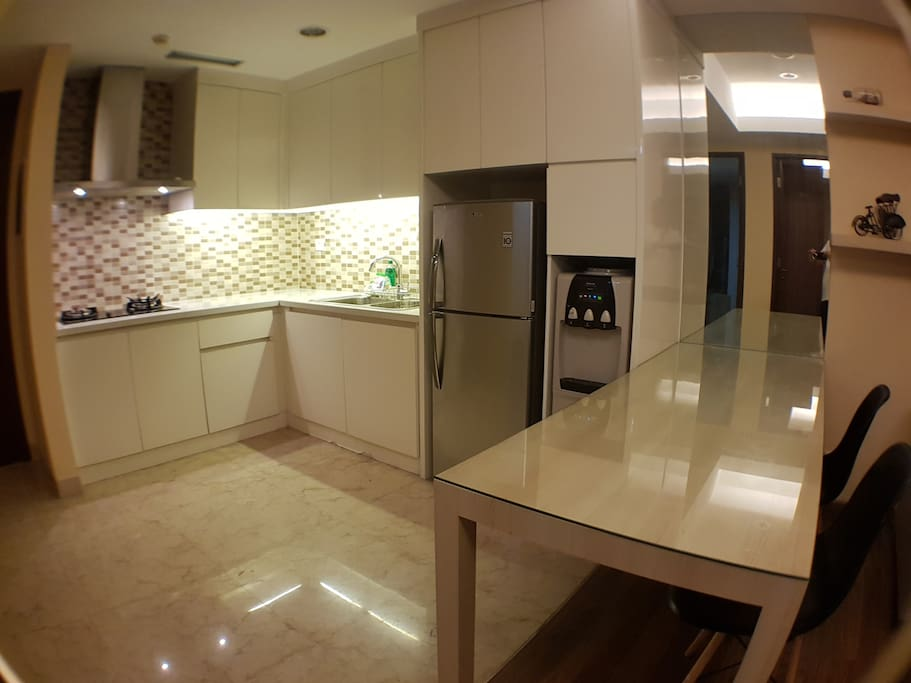 Kitchen with water heater, refrigerator, microwave, Rice Cooker, basic Kitchen utensils and dinner ware sets