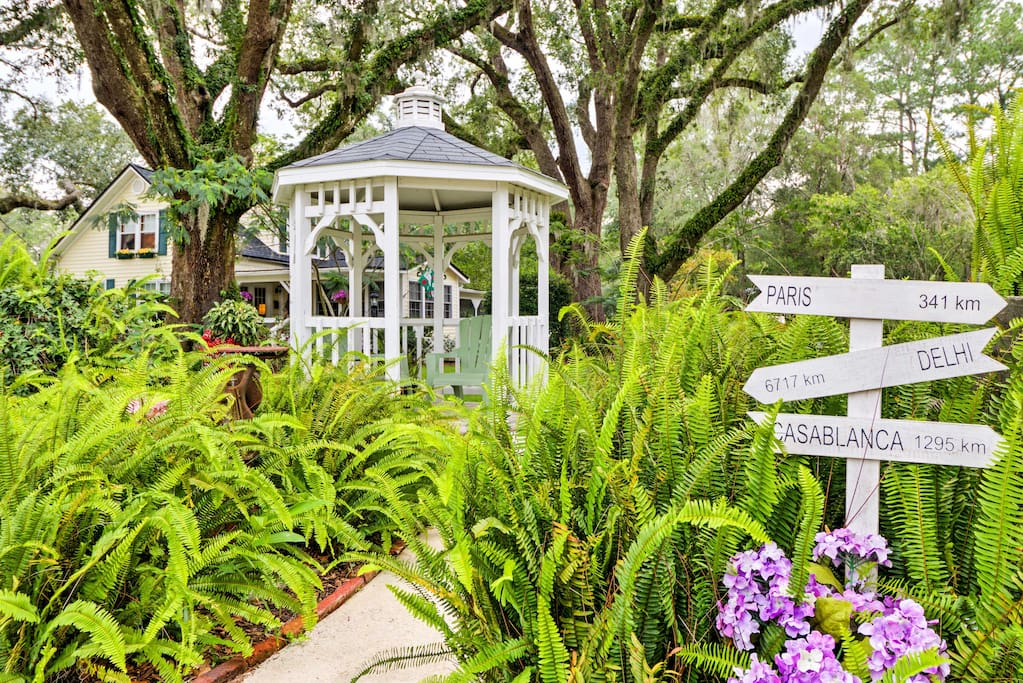 You'll love relaxing in the charming gazebo, surrounded by old Live Oaks.