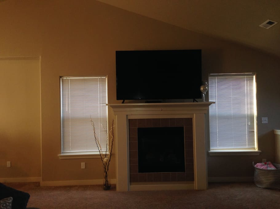 """70"""" TV in the upstairs living room"""