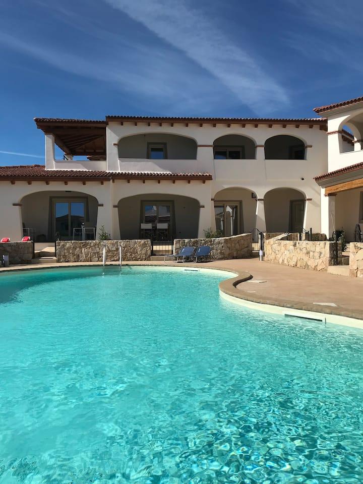 Appartement neuf au rez-de-chaussée avec piscine