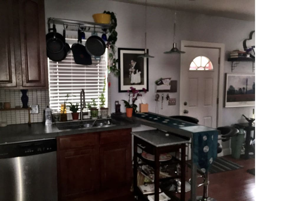 Loft type with concrete counters, large farmhouse sink, eat at counter bar, kitchen cart, dishwasher...