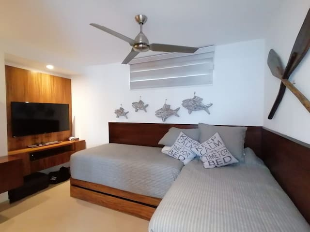 Third bedroom with 3 single beds and TV, ceiling fan, AC and closet