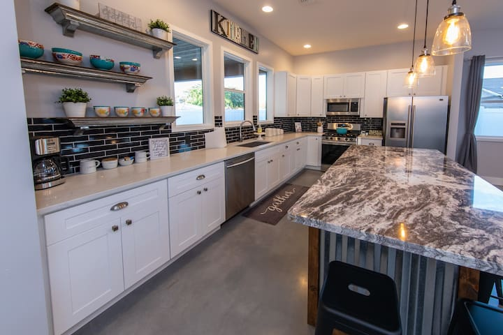 bright, open Kitchen with new appliances and huge granite island, great for entertaining