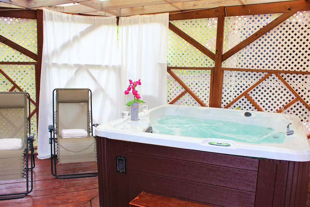 Enjoy a soothing soak in the jacuzzi hot tub