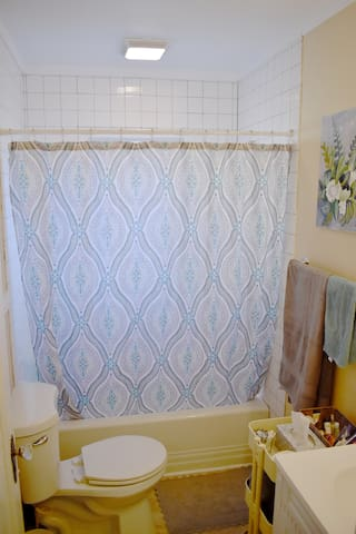 Guest full Bathroom with linens and complimentary toiletries