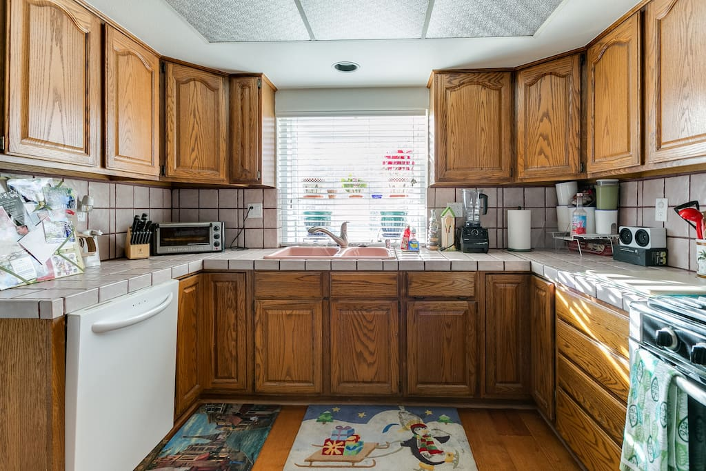 Our Kitchen with all the amenities. Microwave, oven, stove, dishwasher, blender, toaster oven, coffee maker, and Keurig on request.