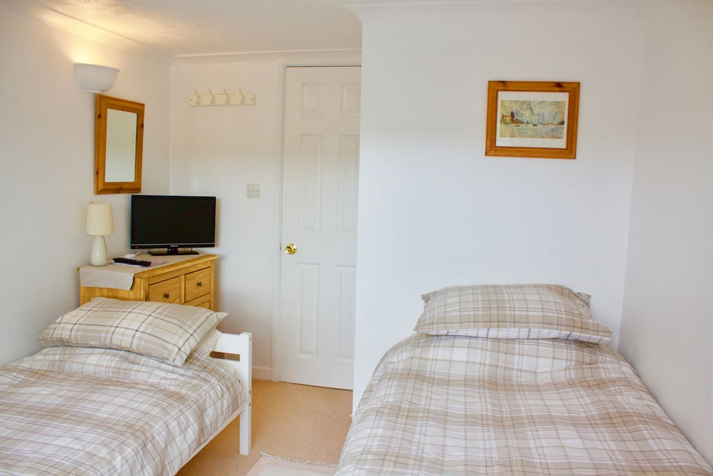 Twin bedded room, chest of drawers and TV. Door leads to Lobby and en Suite, chest of drawers and TV. Door leads to Lobby and en Suite