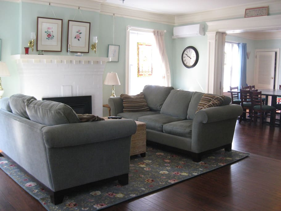 Spacious living room with working gas fireplace, lovely original hardwood floors.