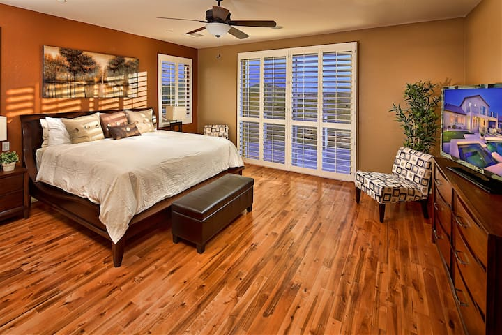 Master suite with viewing balcony, television, and private bathroom.