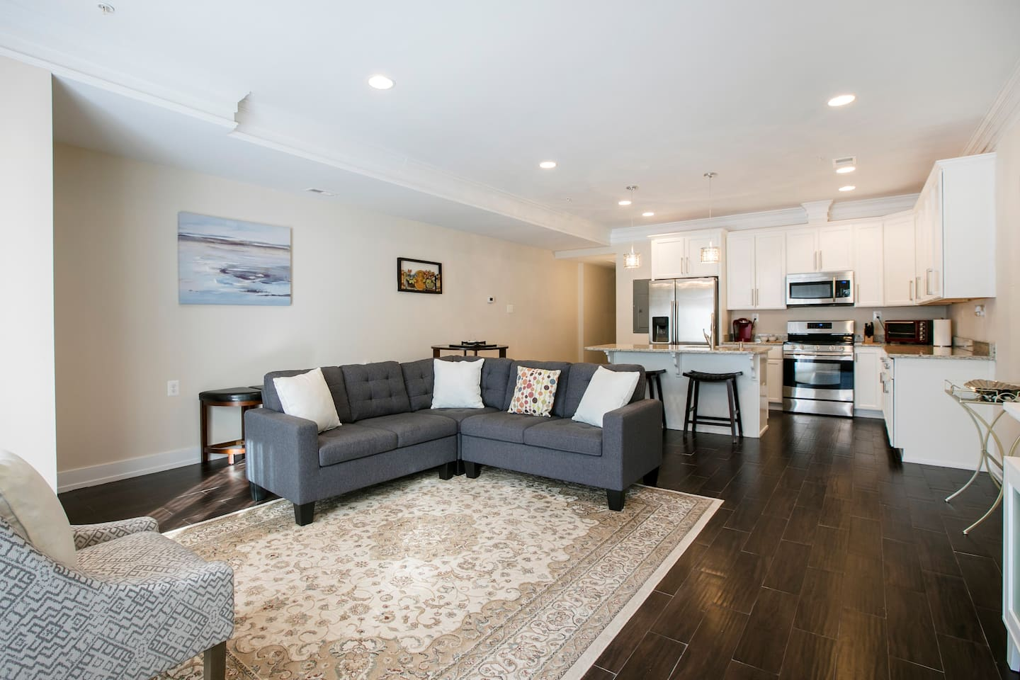 Condominium entrance and living room overview