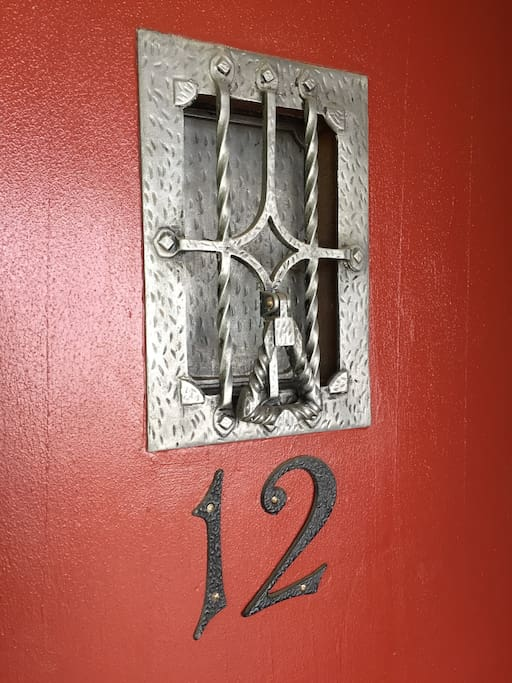 The welcoming entrance with its original 1938 flair.