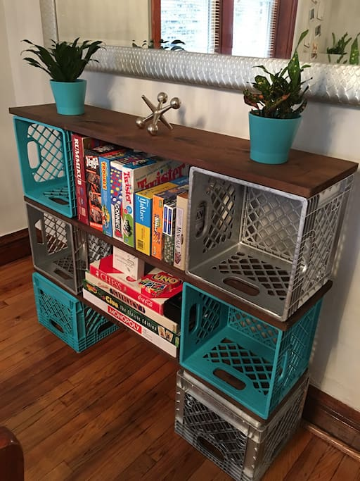 Made out of recycled milk crates and loaded with games and books for your entertainment.