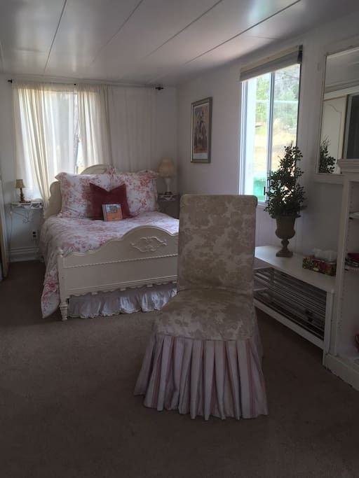 Petite Studio with shabby chic antique bed and chair.