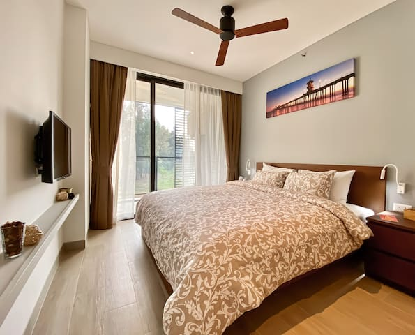 Master bedroom with a king-size bed and private bathroom