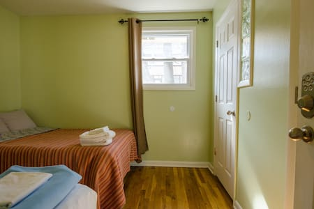 The master bedroom has a full-size bed and twin with half-bath and closet.