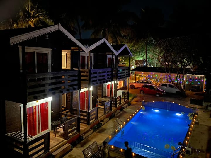 Wooden Swiss cottages with pool @arambol
