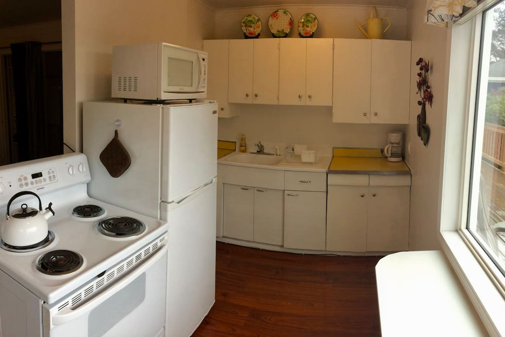 Kitchen opens to living space.