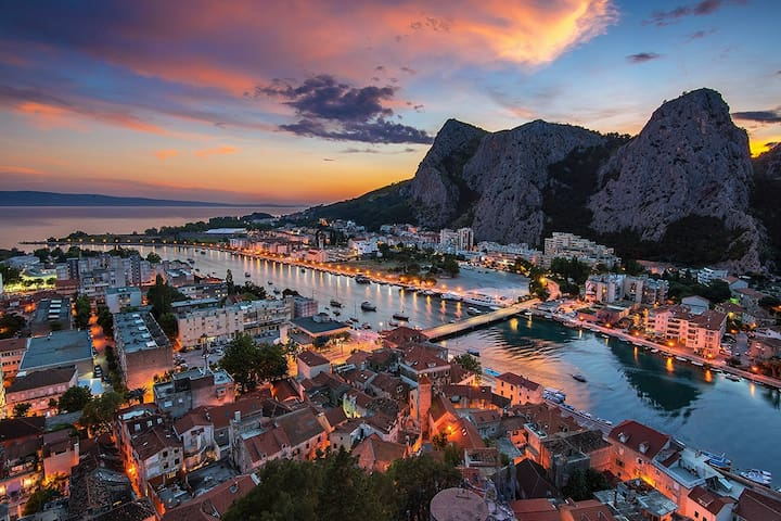 CITY OF OMIS BY NIGHT - CETINA RIVER FLOWS THROUGH THE CITY AND REACHES THE ADRIATIC SEA