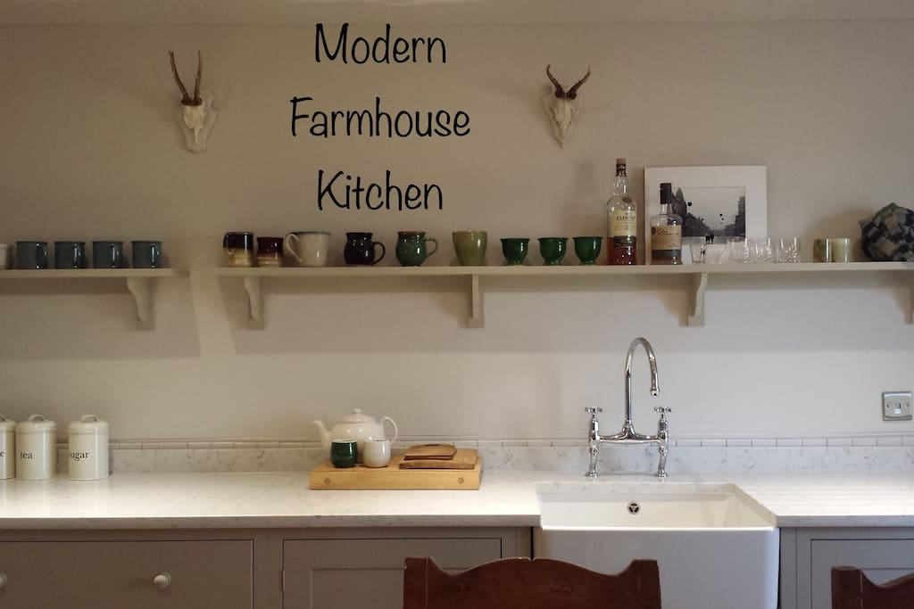 The cottage features a newly renovated DeVOL designed Farmhouse kitchen featuring a range stove, Farmhouse table, marble tops, Belfast sink and a fully stocked pantry.