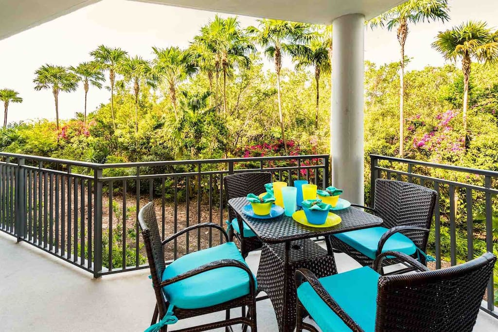 Enjoy a meal on the balcony at the dining set for four...